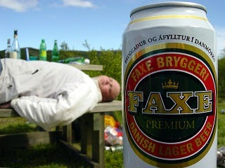 An alcoholic an who is drank sleeping outdoors.