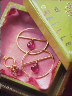 Emitting an intense luster, these hoops are made with tourmalines that were cut hand in a workshop in Jaipur, India. They are displayed next to small machine-cut drops that appear a bit dull.
