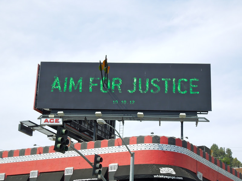 Aim for Justice Arrow installation billboard