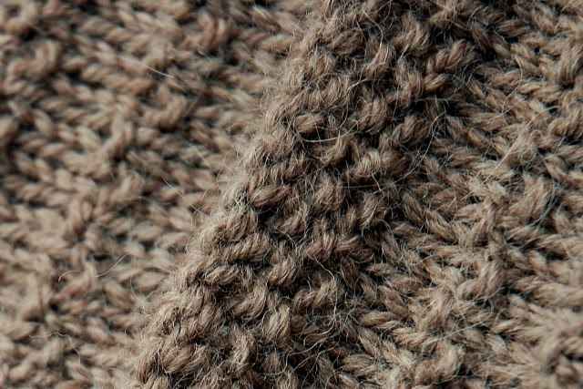 Close up of bound off edge of button band.