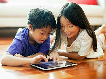 two asians on iPad
