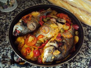 طاجن السمك فى الفرن بالصور للشيف أسامة