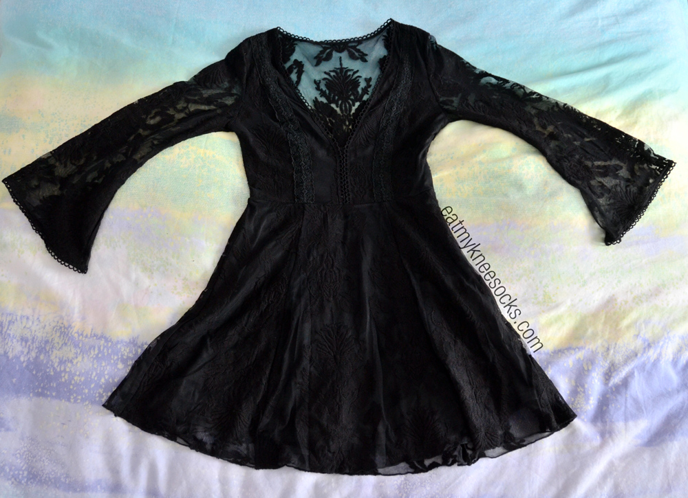 The black v-neck lace dress from SheInside, a dupe of the Free People Reign Over Me dress.
