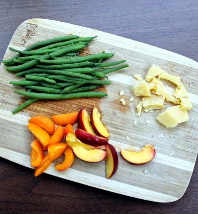 steamed green beans with pepper, sliced apricot and nectarine, and raw aged cheddar
