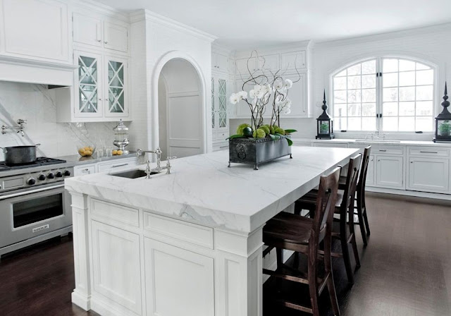 white kitchen marble wood floors simple chrom hardware