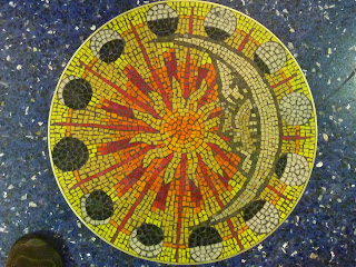 Moon phase mosaic. On the floor of Kansas City International