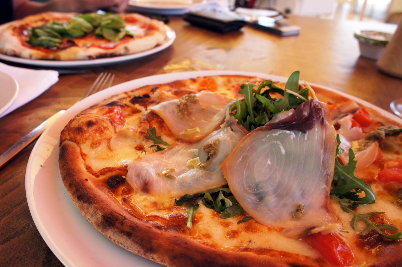 a special smoked swordfish pizza at la cucina del sole tigne point