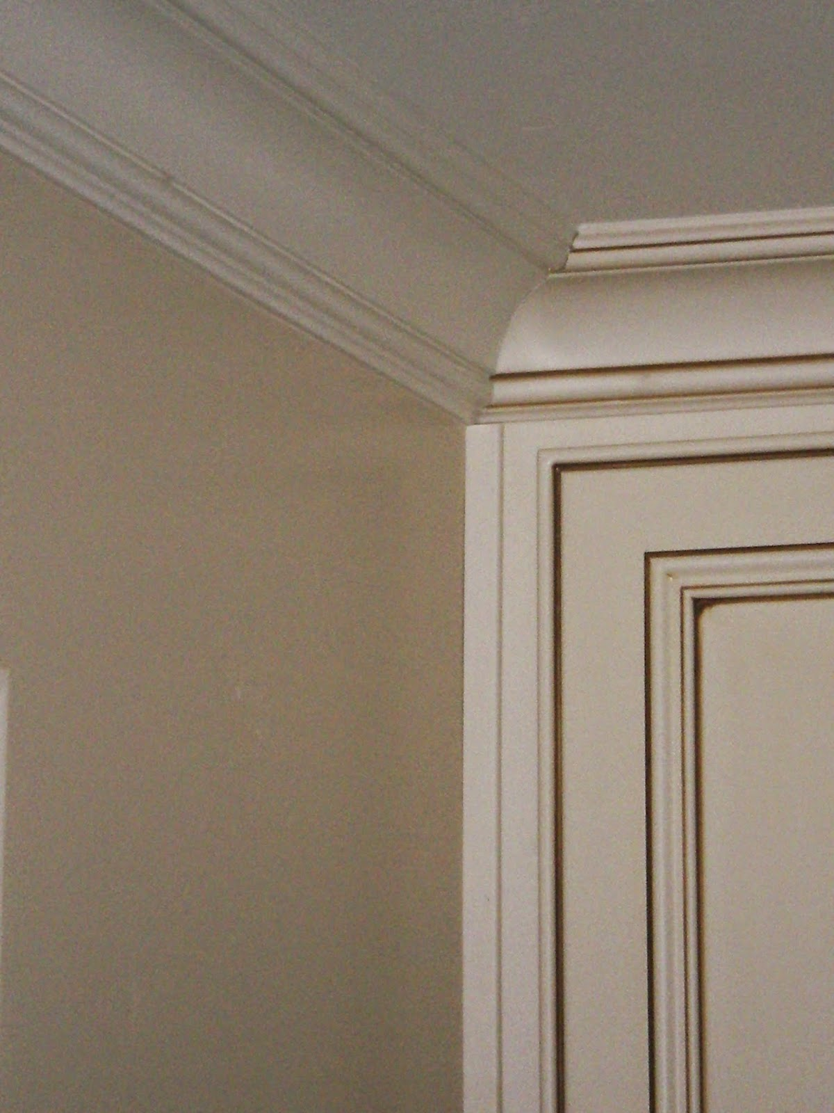 Glazed Cream Cabinets with White Trim