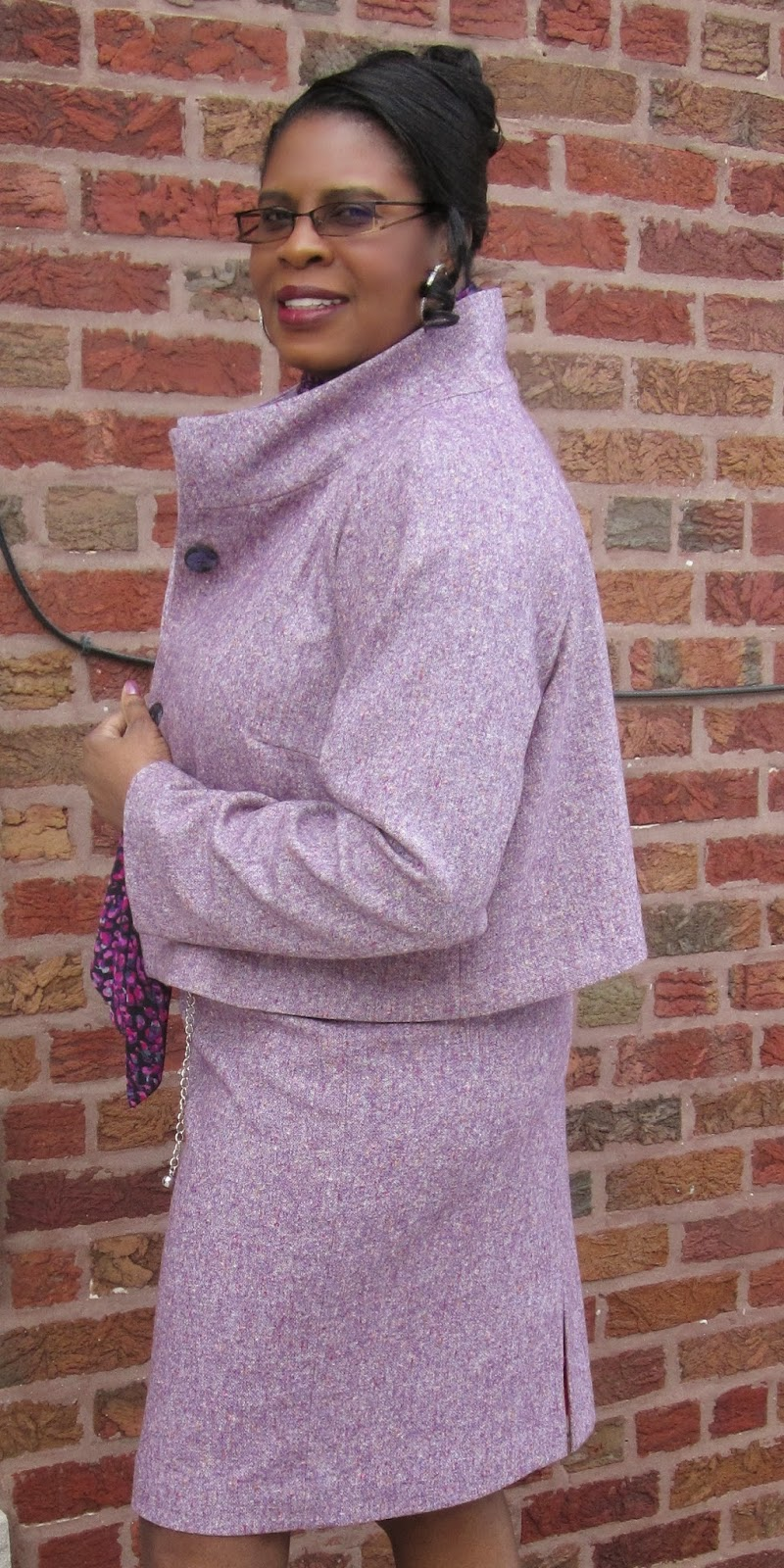 Women's suit made with purple tweed from MoodFabrics.com.