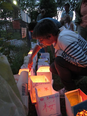 Hiroshima Day Kingston Peace Lantern Ceremony lighting the lanterns