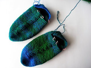 blue and green crocheted cable socks, done through the back of the heels