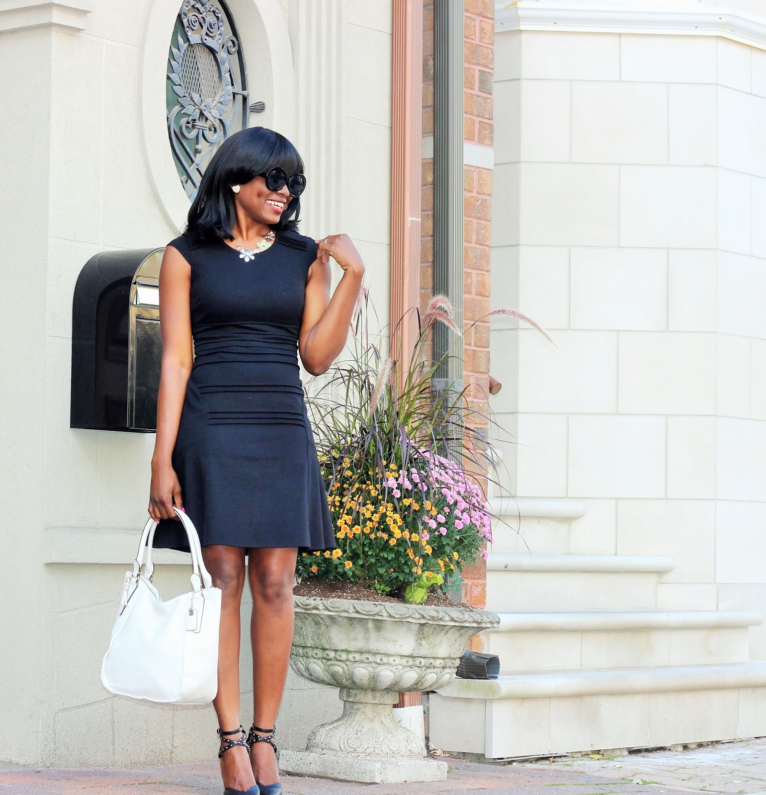 Classically chic: Black Dress, white bag and a red lipstick
