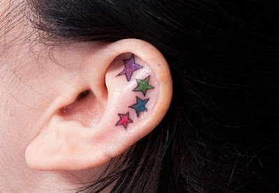 Ear Star Tattoos Designs with Multiple Colors Ranges for hot and sexy look.