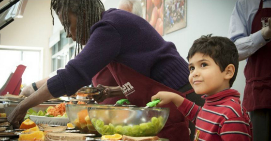 The Conscious Kitchen prepares a lunch at Bayside MLK Jr. Academy. (Photo: Turning Green)