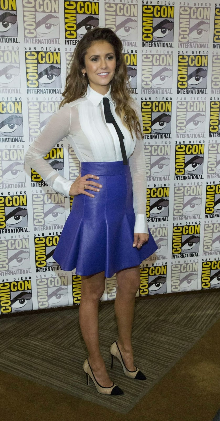 Nina Dobrev flaunts leather skirt and sheer top at the 'Let's Be Cops' Press Line at Comic-Con 2014