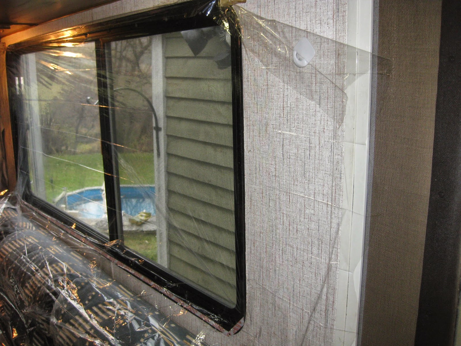 how to insulate windows with clear plastic film our rv life. Black Bedroom Furniture Sets. Home Design Ideas