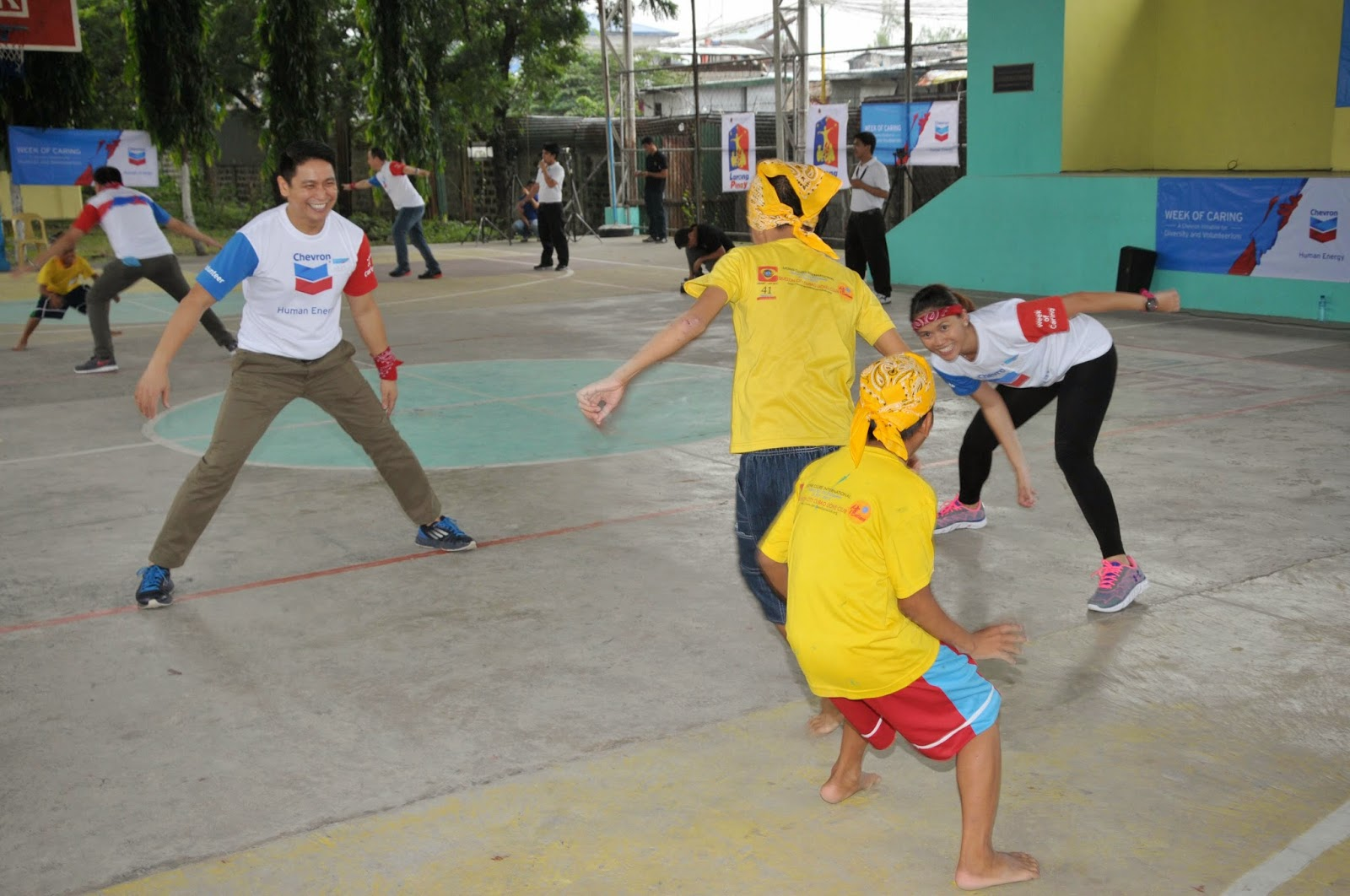 Orphans playing with Chevron volunteers