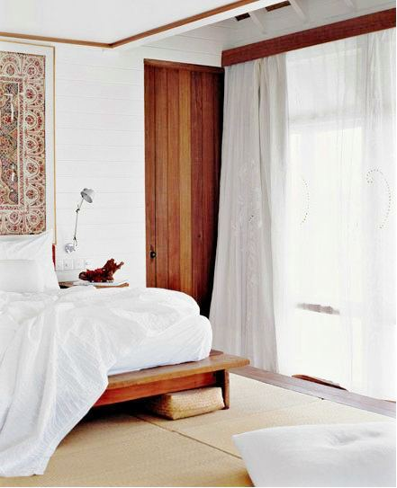 Airy bedroom with atching wood on the platform bed, door, valance and molding on the ceiling