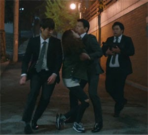 Nam Da Jung falls onto Kwon Yul who urges his bodyguards to carry her.