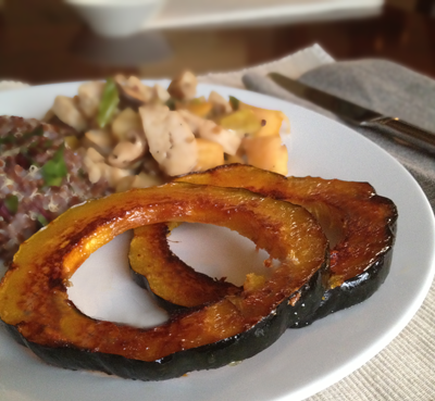 Image of Honey-Ginger Glazed Acorn Squash on a plate with chicken and vegetables