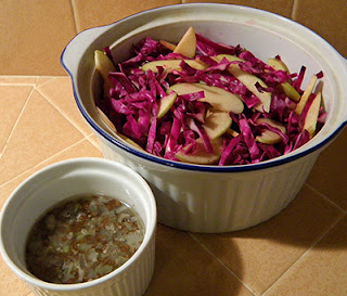 Large Bowl of Salad with Small Bowl of Dressing