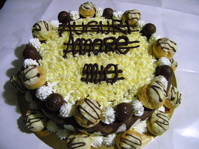 torta cioccolatosa con bigne' e praline  ,passo passo come creare una torta al cioccolato