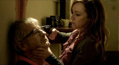 Danielle Harris and John Jarratt in Shiver