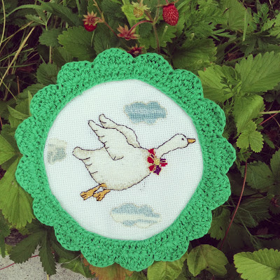 cross stitch flying goose and crocheted frame
