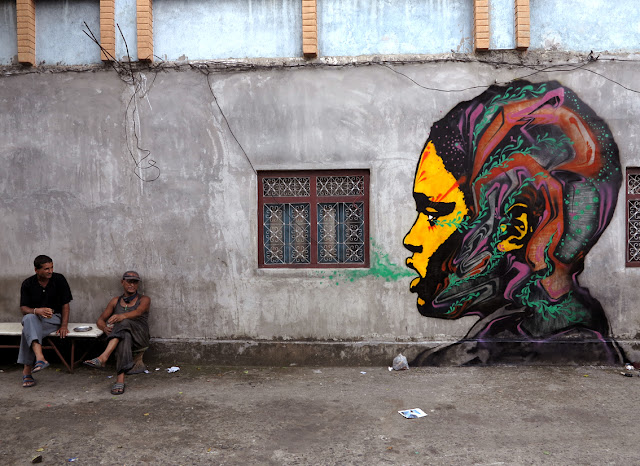 street art by stinkfish in nepal portrait 2