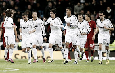 Real Madrid players run after score a goal looking for a comeback