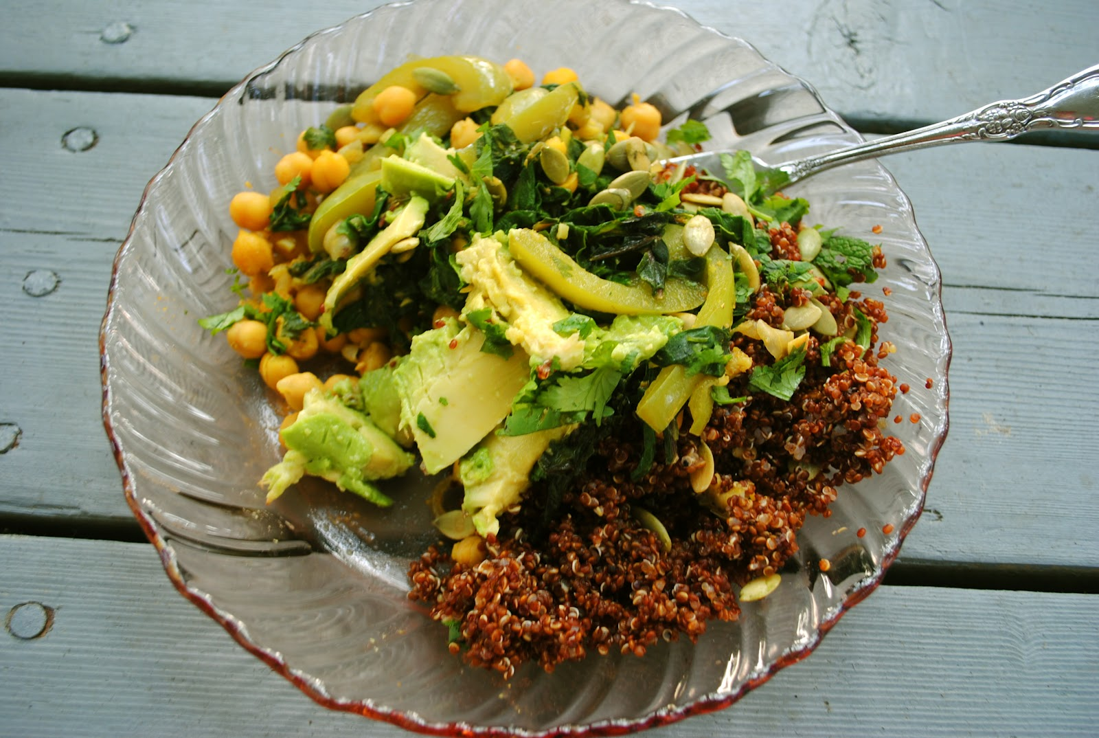Divide quinoa among four bowls and top with vegetables, avocado, and ...