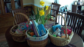 easter baskets with chocolate candy and toys