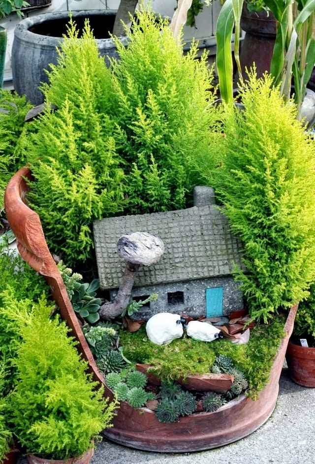 Small Gardens Ideas a fusion courtyard Garden Ideas For Small Gardens Old Flower Pot Plant Moss And Stone Cottage