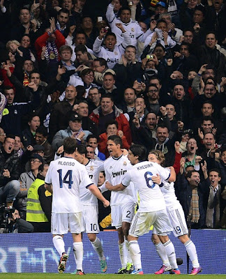 Real Madrid players celebrate a Varane's goal with the fans
