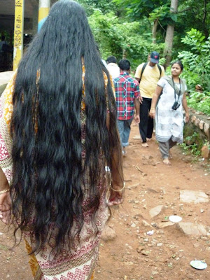 Wet Long hair aunt after enjoying her bath at Courtallam water falls.
