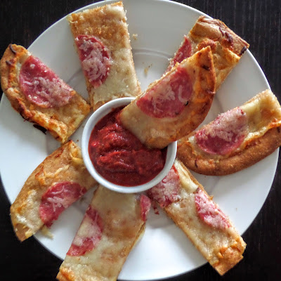 Crispy Pizza Sticks:  Crispy cheesy bread sticks with garlic and salami dipped in marinara sauce.  A great finger food for gameday or a party.