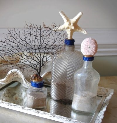 bottles with shells and sea life