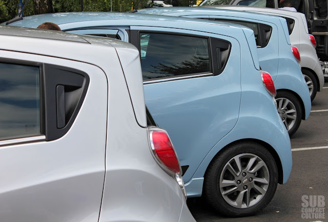 Parked Chevrolet Spark EV models in Portland, Oregon