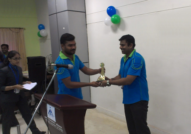 Award presentation for excellent performance to Bhadra Staff