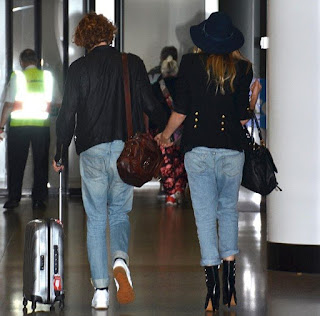 Very easy, but it's casual fashion trend as the Supermodel, Bridget Malcolm, 23, appeared wearing a navy jeans, worn with a huge hat, and stuffed a dark blazer at the airport in Sydney, Australia on Sunday, December 20, 2015.