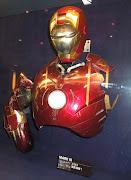 Battle damaged Iron Man Mark III suit on display.