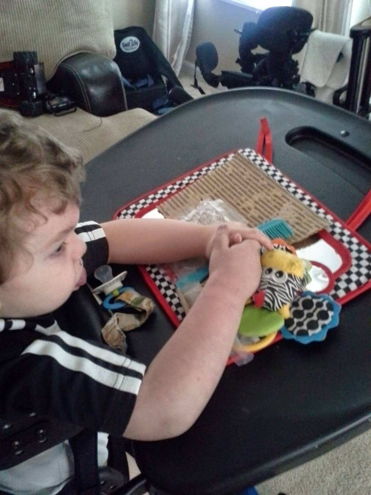 sensory defensiveness deafblind child exploring sounds on a scratchboard