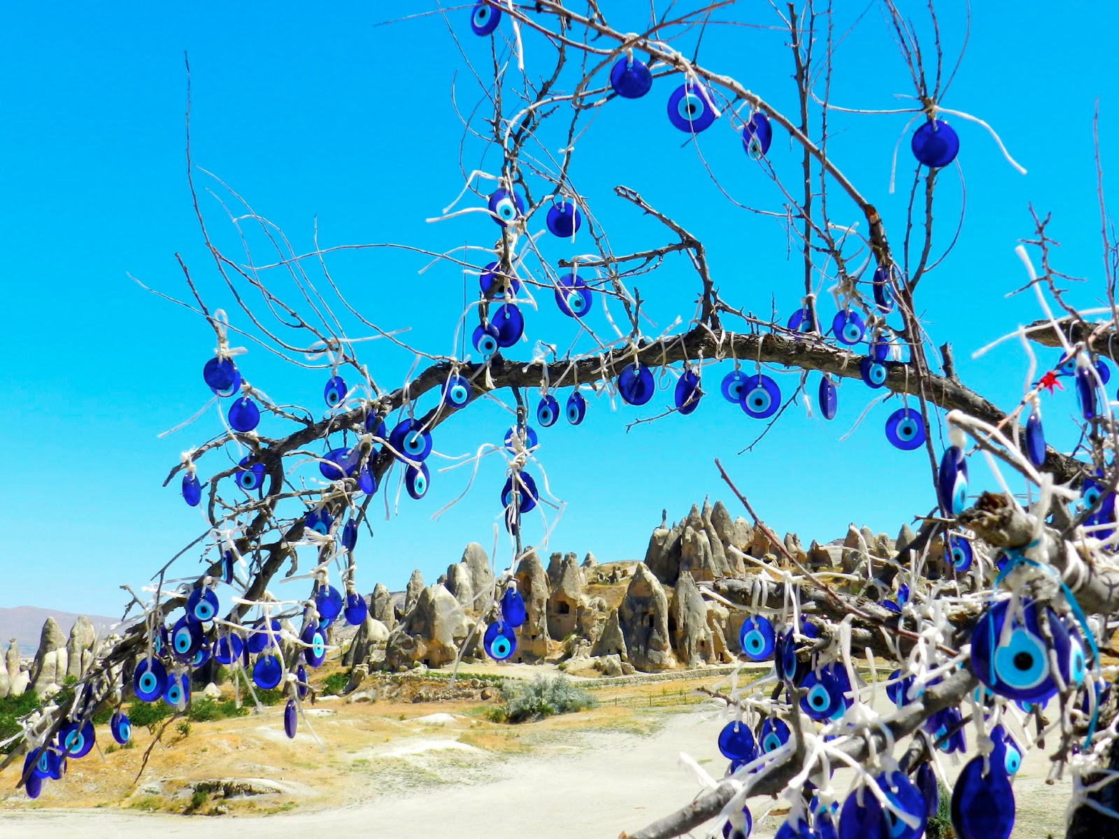 Coffee with hallelujah ballooning across mental landscapes evil eye cappadocian landscape photo by tony martin buycottarizona Image collections