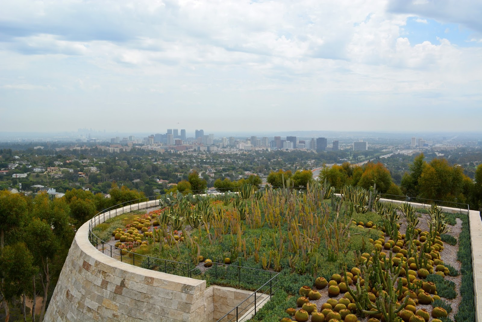 cozy birdhouse | view of los angeles over the getty museum cactus garden