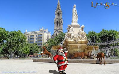 Le Père Noël devant l'esplanade Charles de Gaulle à Nîmes