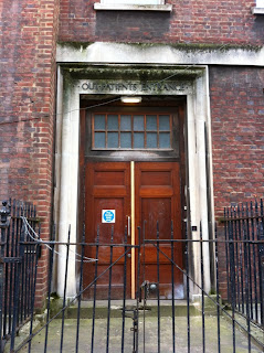 Outpatients Entrance of abandoned London hospital, somewhere near Russell Square, London