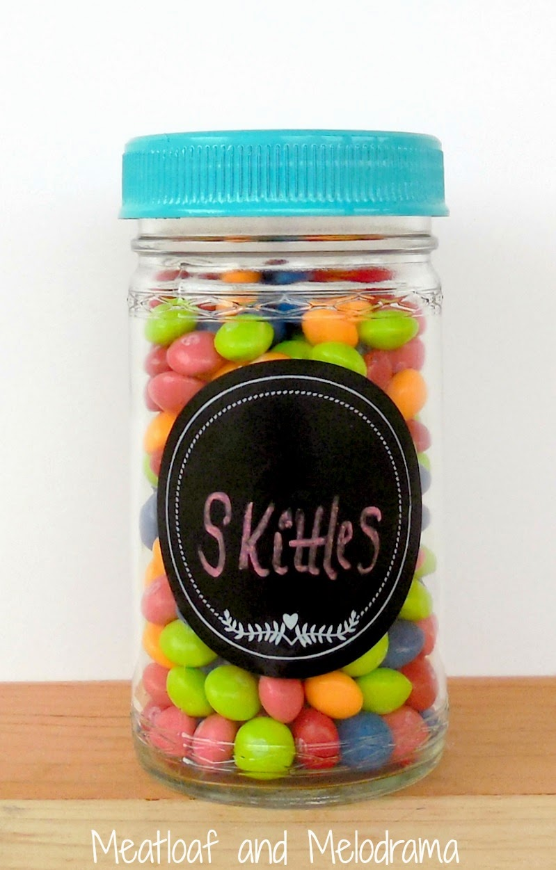 upcycled glass jar of skittles candy with spray painted lid and chalkboard label