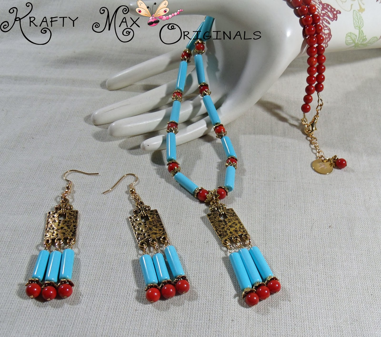 http://www.lajuliet.com/index.php/2013-01-04-15-21-51/ad/gemstone,92/exclusive-red-coral-and-turquoise-gold-plated-necklace-set-a-krafty-max-original-design,200