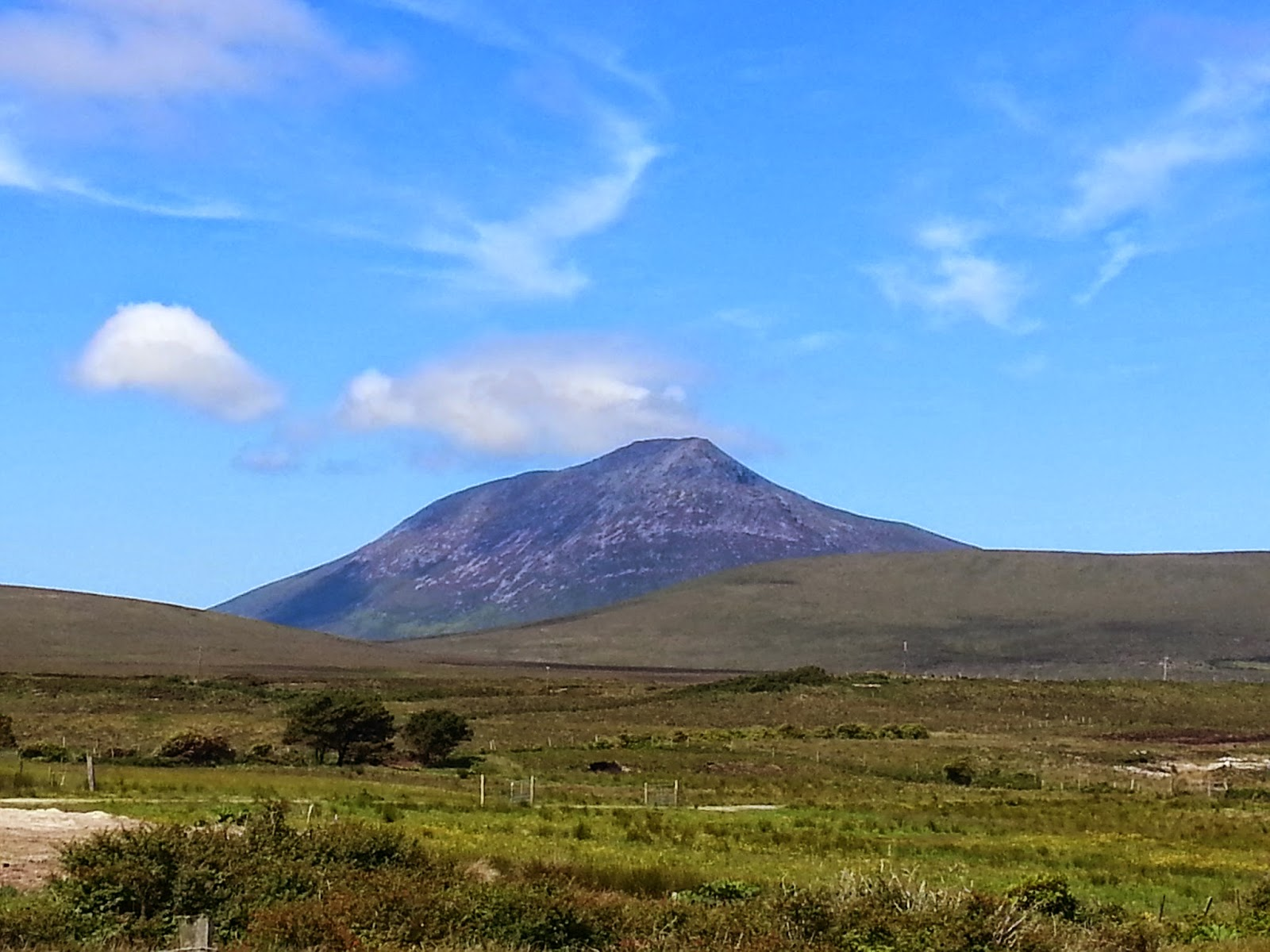 Volcano shaped slievemore mountain on achill island in ireland set against beautiful clear blue sky