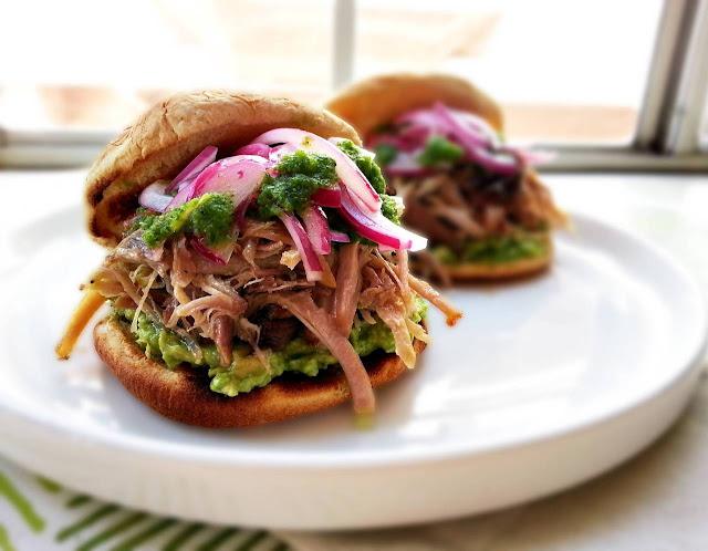 slow roasted pork sandwich with aji cilantro sauce